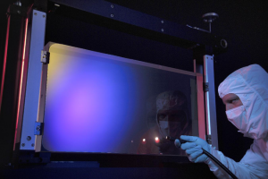 Researcher works with an aperture optic